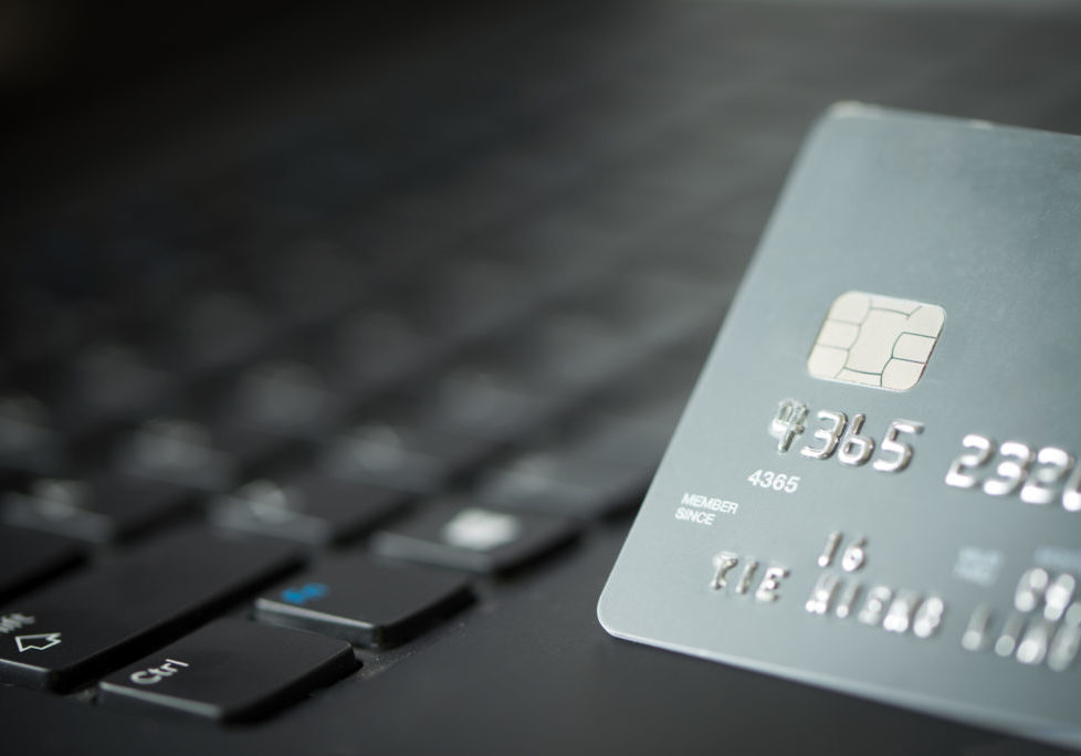 Credit card on laptop for online payment or shopping concept